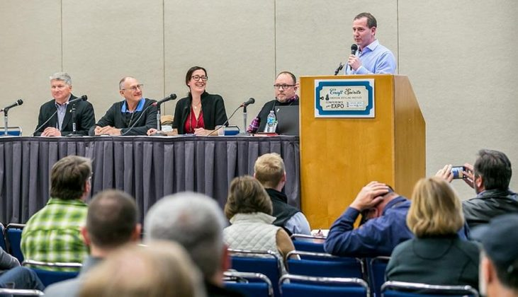 """Andrew Friedman, at podium, moderated the panel discussion """"What Does Your National Sales Team Look Like?"""" Others pictured, from left to right, are Richard Wolf of Wolf Consulting, Henry Preiss of Preiss Imports, Monique Huston of Winebow Group and John Foster of Smooth Ambler Spirits."""