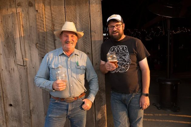 Father and son, Brad and Seth Klann enjoy a beer made from specialty barley grown and malted at Mecca Grade Estate Malts