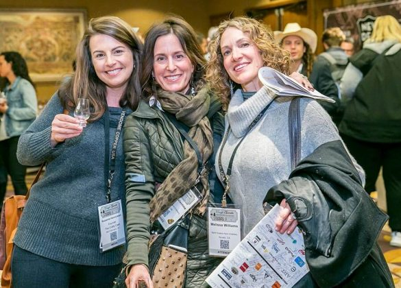 Left to right—Suzanne Henricksen of The Crafty Cask, and sisters Jessica Valentine and Melissa Williams of the Spirit Sisters Farm Distillery share a moment at the opening night reception and tasting.