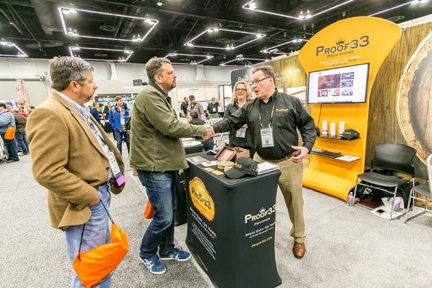 George Quigley, of Proof 33 Provisions, greets a visitor to his booth on the vendor expo floor.