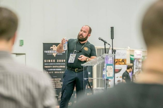 Distiller Chip Tate, of Tate Distillery, speaks to an overflow crowd on the expo stage about how the different aspects of a still affect flavor creation in distilled spirits.