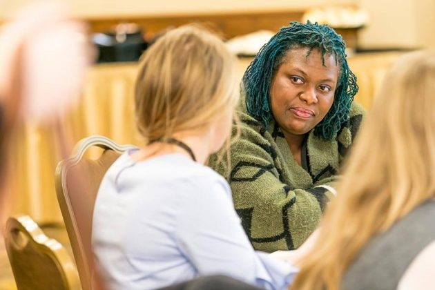 Lee Hedgmon, distiller at McMenamins Edgefield Distillery, takes part in the discussions at the Women's Sum-mit Speed Mentoring.