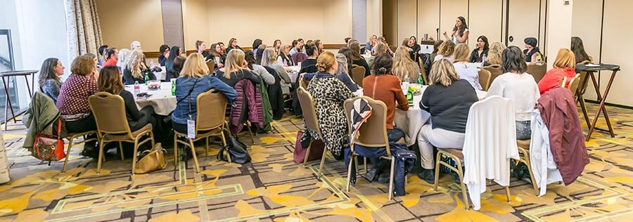 Karen Hoskin, co-founder of Montanya Distillers and president of the Women's Distillery Guild, addresses the Women's Summit.