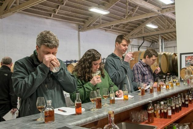 Workshop attendees nose through rum samples at the Two-day Blending and Matura-tion Workshop conducted by Master Blender Nancy Fraley at Bull Run Distilling Co.