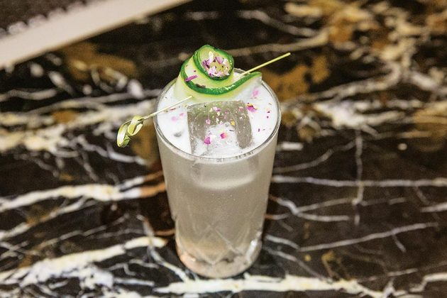 Royal Dinette Smokestack Lightning Cocktail with tequila, mezcal, Lillet, pastis, lemon, sugar, rosemary
