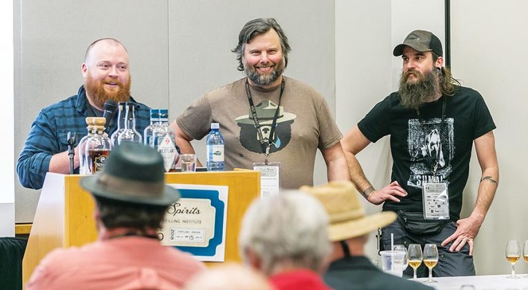Left to right, Matthew Hofmann of Westland Distillery, Christian Krogstad of House Spirits Distillery and Jared Himstedt of Balcones Distilling were three of the six presenters at the American Single Malt Whiskey tasting, one of nine guided spirits tastings at the conference.