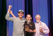 Jeff Kanof, vice president, founding partner Micah Nutt and founding partner Jason Parker celebrate winning the Bubble Cap Award for Distillery of the Year.
