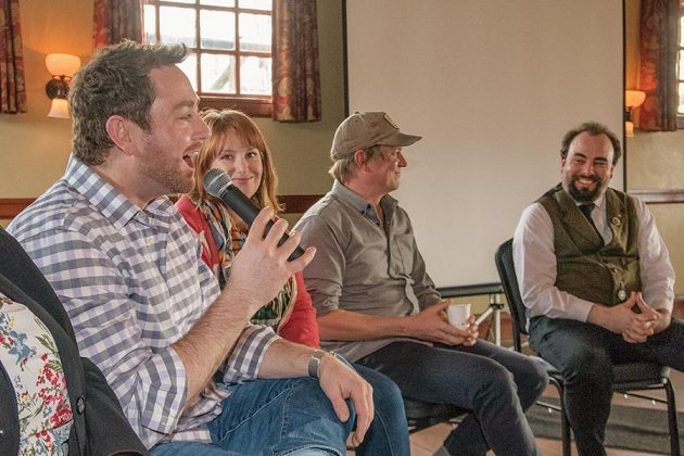Left to right, Ryan Csanky, of Martin Ryan Distilling Co., talks while keli Rivers, Ben Capedvielle and David T. Smith chuckle at his story at the Gin Summit, Saturday, March 24, 2018, in Blackberry Hall at McMenamins Edgefield.