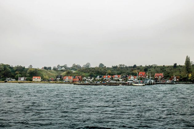 The island of Hven in Sweden, where the Spirit of Hven Distillery is located, as the commuter ferry approaches on a chilly overcast day. Photo © Jake Emen