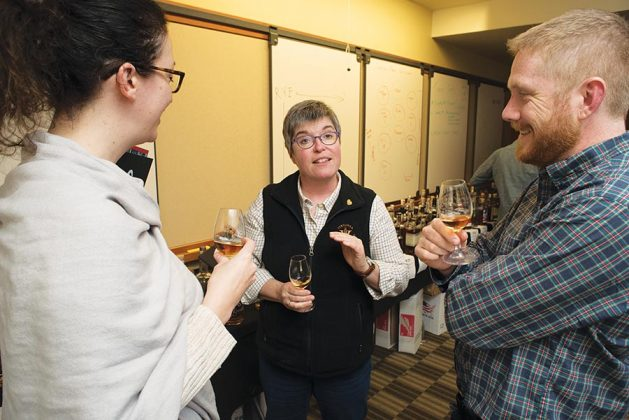 After judging was complete, left to right, Monique Huston of Winebow Group, Lead Judge Nancy Fraley and ADI Marketing Director Matthew Jelen mingle amongst the spirits, sharing stories and exploring the bottles.