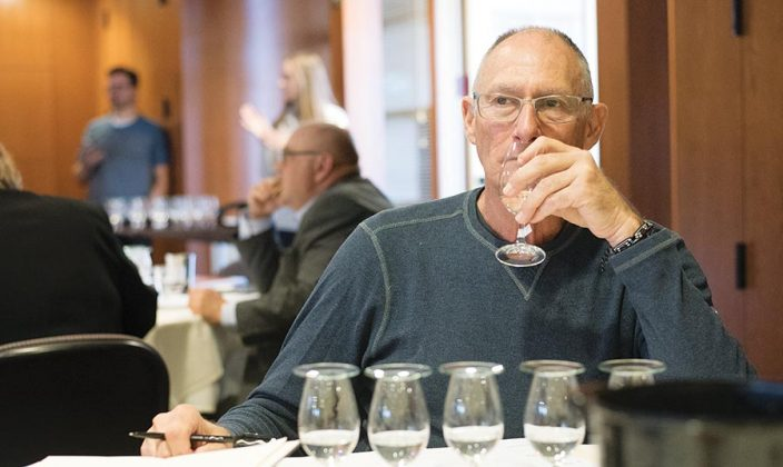 Henry Preiss, of Preiss Imports, concentrates on the many aromas of the spirit in hand, one of several in the flight in front him.