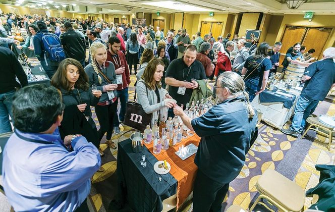 Distiller Rick Rickard of Rolling River Spirits dispenses samples of his spirits at the opening night reception and tasting at the DoubleTree Portland.