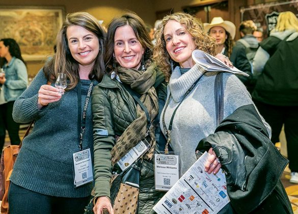 Left to right—Suzanne Henricksen of The Crafty Cask, and sisters Jessica Valentine and Melissa Williams of the Spirit Sisters Farm Distillery share a moment at the opening night reception and tasting