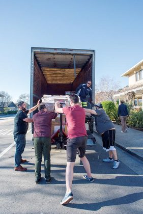 Top—As pallets of cases of spirits arrive at the Lodge at Tiburon, left to right, Eric Zandona, David T. Smith, Joe Barber and Justin Koury work to steady a load that is coming down the lift gate.