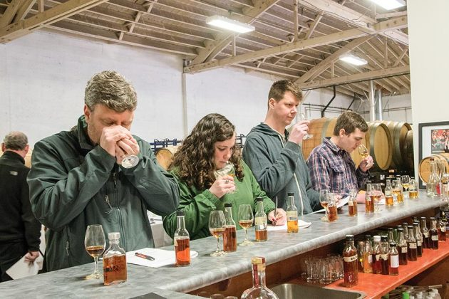 Workshop attendees nose through rum samples at the Two-day Blending and Maturation Workshop conducted by Master Blender Nancy Fraley at Bull Run Distilling Co.