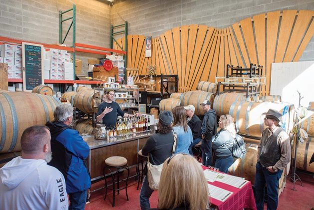A distillery bus tour winds through the tasting room and enjoys samples at Stone Barn Brandyworks.