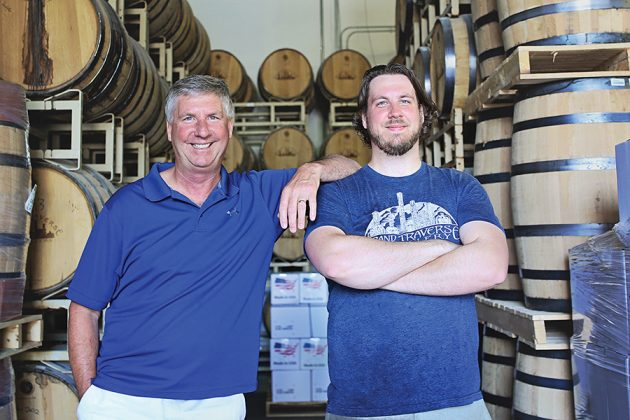 Kent Rabish, left, owner and president of Grand Traverse Distillery in Grand Traverse, MI, and head distiller Landis Rabish recently released Ole George Maple Finished Straight Rye Whiskey Bottled-in-Bond.